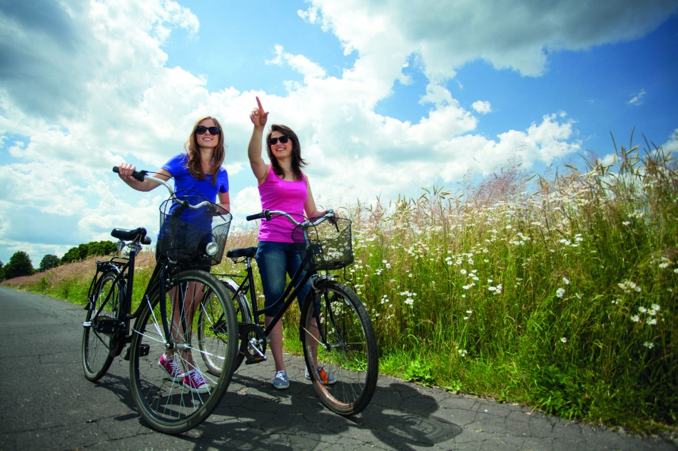 Girls on a bicycle trip in the country